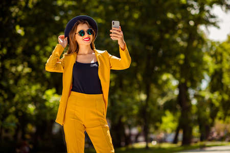 Portrait of her she nice-looking gorgeous attractive lovely pretty cheerful confident trendy fashionable girl taking making selfie on fresh air in green forest wood outdoors