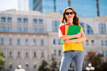 Portrait of her she nice attractive lovely confident cheerful cheery wavy-haired girl hugging holding, materials learning foreign international culture in downtown center outdoor Imagens