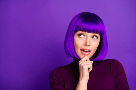 Close up photo of minded youth touching her chin looking up wearing turtleneck isolated over purple violet background