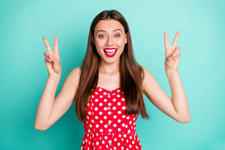 Close-up portrait of her she nice-looking attractive lovely winsome cheerful cheery glad funny funky straight-haired girl showing v-sign isolated, over green blue turquoise bright vivid shine background Фото со стока