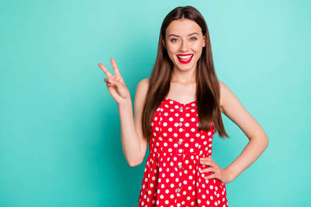 Portrait of her she nice attractive lovely lovable perfect cheerful cheery glad funny content straight-haired girl showing v-sign isolated over, green blue turquoise bright vivid shine background Фото со стока
