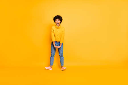 Full length body size view of nice attractive cheerful cheery funky childish crazy wavy-haired, girl having fun leisure isolated over bright vivid shine vibrant yellow color background