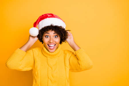 Its my size. Close up photo of glad optimistic lucky rejoicing overjoyed girl trying to wear hat on head and curly wavy hairstyle isolated bright color background