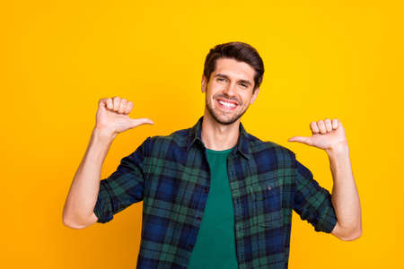 I am best. Photo of amazing guy indicating thumb fingers on himself wear casual checkered shirt isolated yellow color background Stockfoto