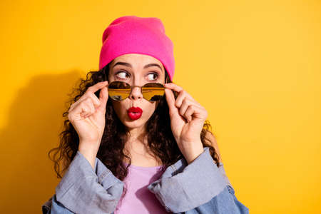Closeup photo of nice lady looking with fear to empty space have heard private rumour wear casual trendy clothes isolated yellow color background