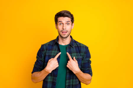 Photo of amazing guy indicating finger on his chest not believe everybody blaming him wear casual plaid shirt isolated yellow color background