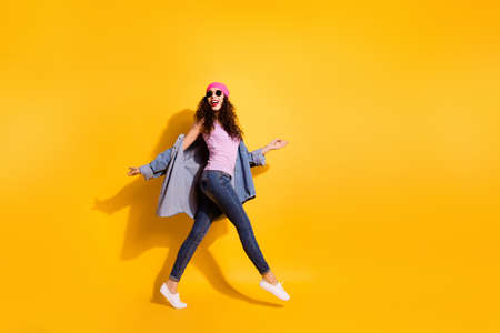 Full size profile photo of lovely content girl have free time walk feel excited wear good modern look isolated over yellow color background