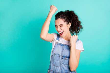 Close-up portrait of her she nice attractive charming cheerful cheery wavy-haired girl holding fists celebrating best winning luck attainment isolated on bright vivid shine green turquoise background