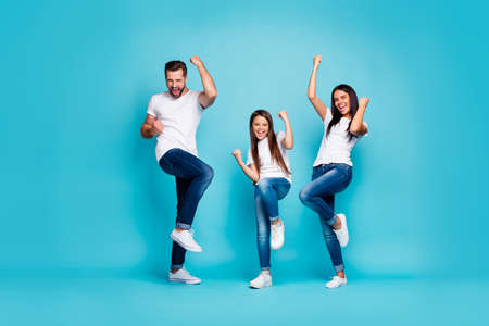 Full body photo of daddy mommy and small lady raising fists air rejoicing wear casual outfit isolated blue background Banque d'images