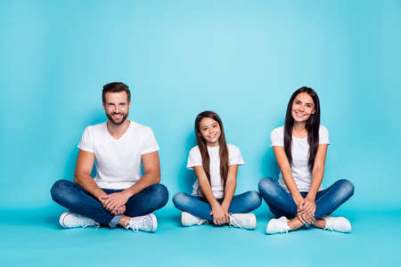 Photo of amazing family sitting floor overjoyed wear casual outfit isolated blue background