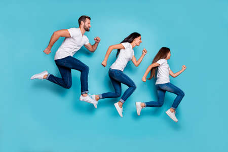 Full length body size photo of running sporty family being healthy and beautiful while isolated with blue background