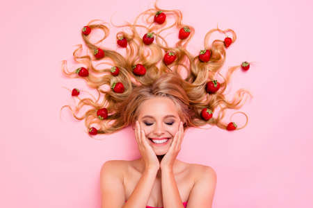 Close up top above high angle view photo beautiful very glad skin condition she her lady lying down among fruits strawberries long hair full vitamins complex eyes closed isolated pink background