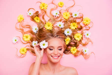 Close up top above high angle view photo beautiful she her amazing lady lying down among flowers long curly wavy hair spring summer eyes closed inspiration imaginary flight isolated pink background