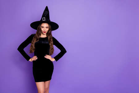 Portrait of beautiful spooky creepy gothic woman witch short mini dress want conjure say spells on october theme party isolated over purple violet color background
