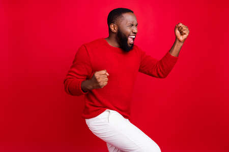 Portrait of his he nice attractive cheerful cheery ecstatic dreamy satisfied glad bearded guy fan dancing celebrating good news great attainment isolated over bright vivid shine red background Stockfoto - 130395834