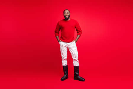 Full length body size view of his he nice attractive cheerful cheery content bearded guy wearing modern look outfit hipster isolated over bright vivid shine red background