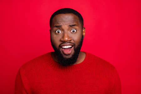 Close-up portrait of his he nice attractive cheerful cheery funny bearded guy boyfriend incredible news funky mood isolated over bright vivid shine red background