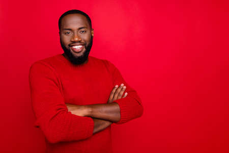 Portrait of his he nice attractive virile masculine cheerful cheery content bearded guy folded arms isolated over bright vivid shine red background Stock Photo