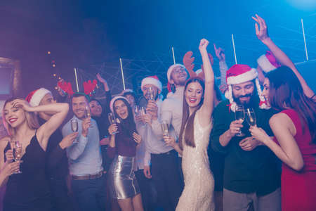 Portrait of nice-looking attractive glamorous smart stylish elegant cheerful cheery positive girls and guys having fun chill out rest relax celebratory in luxury place fogged nightclub indoors