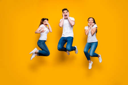Full length body size view portrait of three nice attractive lovely slim fit cheerful cheery glad excited person expressing good crazy mood isolated over bright vivid shine yellow background