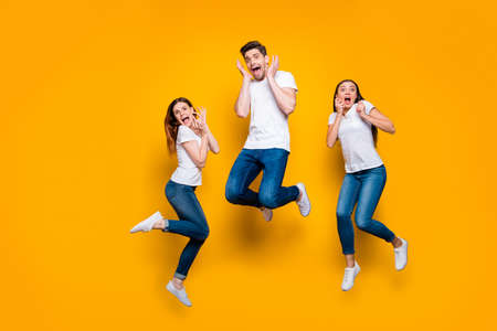 Full length body size view portrait of three nice attractive scared worried funny funky person expressing fear feeling isolated over bright vivid shine yellow background 免版税图像