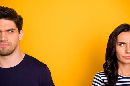 Close-up cropped portrait of his he her she nice attractive lovely moody sullen offended annoyed irritated people marriage divorce life partners isolated over bright vivid shine yellow background