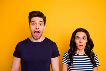 Close-up portrait of his he her she nice attractive lovely horrified people married, spouses stupor expression bad news isolated over bright vivid shine yellow background