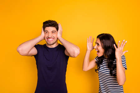 Portrait of nice attractive irritated annoyed sullen gloomy grumpy aggressive, married spouses having anger pretense argument fail failure crisis isolated on bright vivid shine yellow background Фото со стока