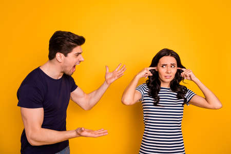 Portrait of nice attractive depressed devastated gloomy grumpy aggressive married spouses having argument disagreement pretense failure crisis period isolated on bright vivid shine yellow background