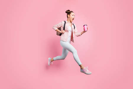 Full length body size profile side view portrait of her she nice attractive, charming lovely shine slender worried girl running fast late first lecture isolated over pink pastel background