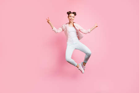 Full length body size view portrait of her she nice attractive charming, lovely winsome slender cheerful cheery girl showing double v-sign having fun isolated over pink pastel background Фото со стока