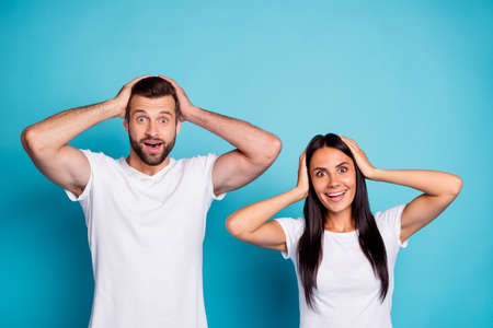 Photo of excited pair not believe successful happening wear casual outfit, isolated blue background