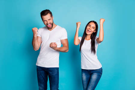 Photo of overjoyed pair celebrating, lottery winning wear casual outfit isolated blue background Фото со стока