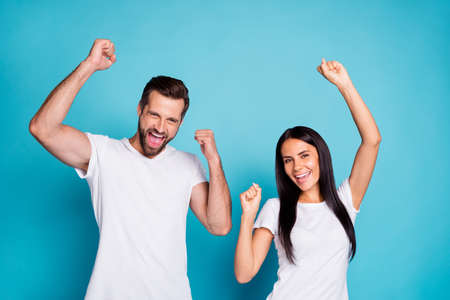 Photo of overjoyed pair celebrating lottery winning wear casual outfit, isolated blue background