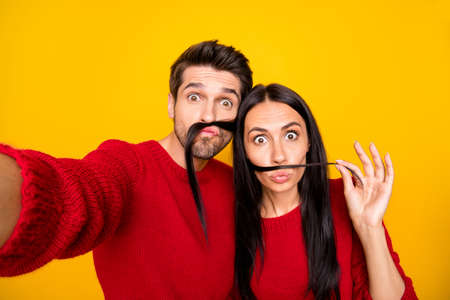 Close up photo of charming lady and her guy take selfie fool with lips pouted plump wear red jumper isolated over yellow background