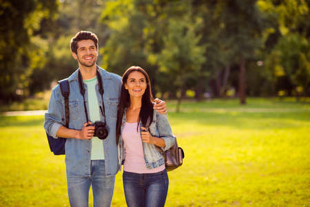 Her she his he nice attractive lovely cheerful cheery married spouses travelers eco friendly tourists spending honey moon on fresh air exploring the world wandering in green wood forest Banque d'images