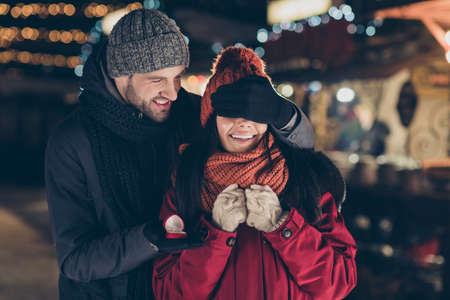 Marry me. Portrait of his he her she nice attractive charming lovely cheerful cheery couple wearing warm outfit guy making proposal giving engagement ring 14 February honeymoon outdoors Stock Photo