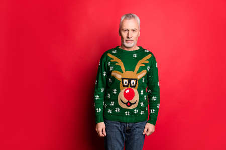 X-mas tradition theme party dress-code concept. Photo of optimistic cheerful glad old guy wearing green colored knitted cozy handmade jumper pullover isolated bright background