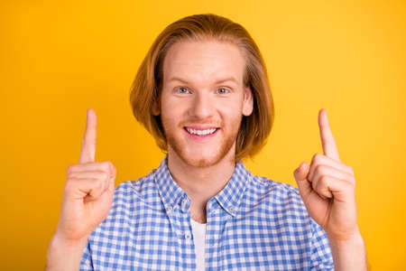 Photo of cheerful funny positive closeup freelance guy pointing up for you to subscribe his profile in social media isolated over bright color background