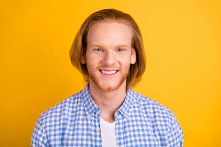 Close up photo of carefree cheerful nice cute freelancer wearing checkered shirt smiling toothily isolated over vivid color background