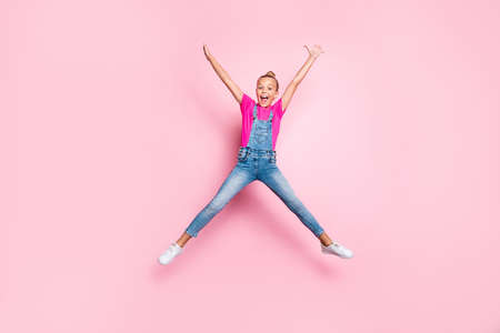 Full length body size photo of cheerful cute stylish trendy top-knot nice shouting girl shaping star with her body wearing jeans t-shirt rejoicing overjoyed isolated over pink pastel color background
