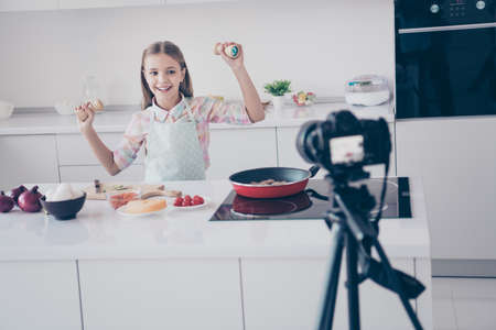 Portrait of her she nice attractive beautiful charming lovely cute cheerful cheery glad pre-teen girl making useful salad dancing recording video lesson in light white interior kitchen house indoors