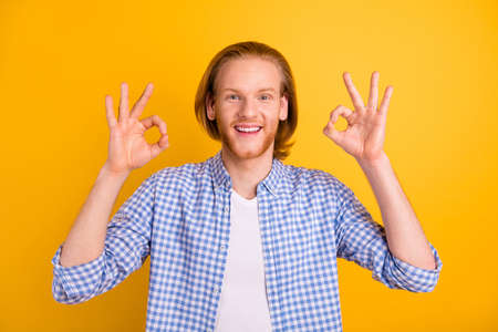 Photo of cheerful nice handsome attractive guy showing you double ok sign to emphasize quality of product isolated over vibrant color background