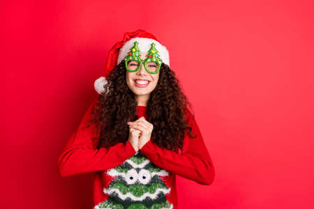 Portrait of her she nice attractive lovely cute cheerful cheery dreamy wavy-haired Santa girl asking desirable gift isolated over bright vivid shine vibrant red color background