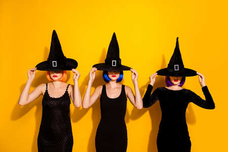 Photo of three thrilling disguise haunted devil evil macabre charmed ladies hiding their faces do not want to look at you isolated bright color background Archivio Fotografico - 130740367
