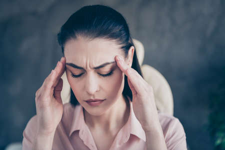 Close up photo of enduring tired woman sad upset unhappy about to cry with her business empire crashed with head dizzy hurt pain aching Stock Photo