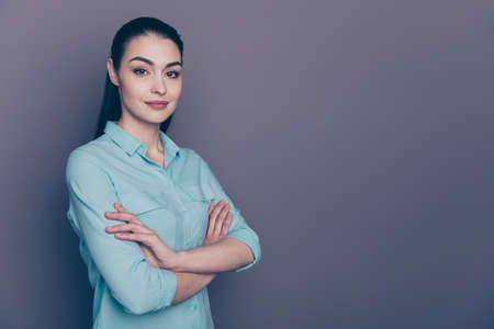 Photo of charming sweet business cute smiling joyful professional attorney journalist standing with hands folded staring with her deep hazel eyes isolated over grey color background Stock fotó