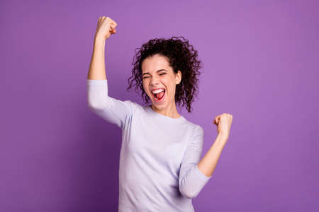 Closeup photo of amazing wild lady win competition raising fists celebrating cool achievement yelling loud wear casual pullover isolated purple color background