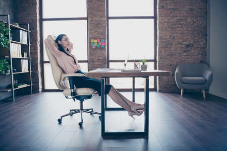 Full length body size photo of resting relaxing girl employed just for work in transnational company wearing formally heels shoes sitting at desktop