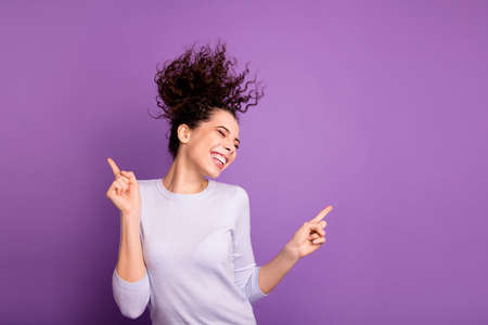 Portrait of her she nice attractive lovely winsome pretty dreamy cheerful cheery wavy-haired girl having fun dancing chill out isolated over violet lilac purple pastel color background Stock Photo